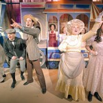"""""""Hello Dolly"""" cast members (left to right) Anthony Plummer, Nate Barham, Zachary Rice, Tina McClure, Musette Hays and Ian Sansborn perform during a photo call for the Regional Theatre of the Palouse production of the musical."""