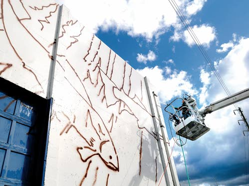 Work on what will be the region's largest outdoor mural resumes