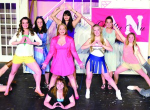 Cast members playing Delta Nu sorority sisters surround Alaina Swearingen, who plays Elle Woods in Lewiston Civic Theatre's Production of Legally Blonde The Musical.