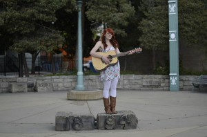 """Jodi Marie Fisher plays guitar in a scene for her recently recorded music video """"I Miss You."""""""