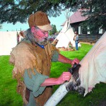 Ronzo Repphun of Weippe cleans a buckskin. Repphun will explain traditions and skills of the mountain men at Weippe's Camas Festival Saturday.