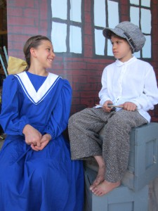 Emma Mitchem, 12, plays Pollyanna and sits with Jimmy Bean, a character double-cast by two local girls.