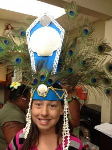 """Sajsteen or """"Kaleolani,"""" 10, sports a headdress that she wore for a dance at a Kumu Hula O Lei Kukui O Moloka'i mini-show performance on June 8 at Colortyme in Clarkston. The Kamehameha Day Celebration, a Polynesian dinner and show, will take place at 5:30 p.m. June 22 at the Hells Canyon Yacht Club."""