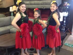 """From left to right, Kiara or """"Hokulani,"""" 14, Sajsteen or """"Kaleolani,"""" 10, and Kelani, 12, are hula sisters of Kumu Hula O Lei Kukui O Moloka'i. They pose in hula attire for a dance at a Kumu Hula O Lei Kukui O Moloka'i mini-show performance on June 8 at Colortyme in Clarkston."""