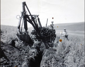 Duane Roach Collection | Courtesy A homemade backhoe, built by Wayne Roach on a Model K, Allis Chalmers tractor. It was used to dig trenches for laying tile to drain agricultural land, a hallmark of Roach Construction then and now.