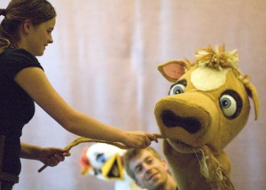 "Gus Rose-Witt, left, as Jack, interacts with a cow played by Cory Williamson in the Idaho Repertory Theatre production of ""Jack and the Beanstalk."""