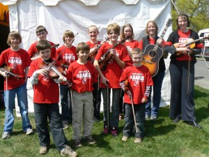 Junior Jammers, a group of fiddle players, pose at Moscow's 2008 Renaissance Fair.