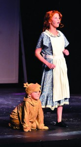 "Maddie Hass sings ""Tomorrow"" with the help of Charlie Owen as Sandy in Lewiston Civic Theatre's production of ""Annie Jr."""