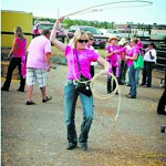 A woman tries her hand at roping at a Montana Chicks n Chaps event. This year the fundraiser comes to the Lewiston Roundup.