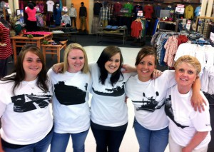 Women pose in Garth Meyer's Palouse photo-designed T-shirts for a Facebook promotion on the TriState Outfitters page.