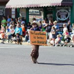 A child marches in the 2012 Kamiah BBQ Days Parade.