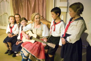 "Katie McDougall as Maria Rainer sings with the Von Trapp children in a scene from the Regional Theatre of the Palouse's production of ""The Sound of Music."""