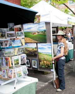 Alison Meyer stands in front of her Farmers Market booth near Friendship Square in Moscow.