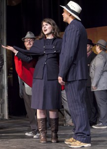 """Sarah Brown, center, played by Nancy Means, sings to Sky Masterson, played by Travis Chase, during rehearsal for the Moscow Civic Theatre production of """"Guys and Dolls"""" at the Kenworthy Performing Arts Centre in Moscow on  Oct. 24."""