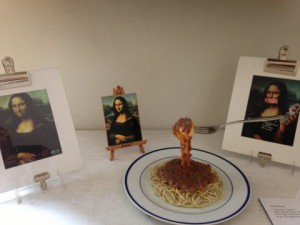 An original of Gene Rosa, this Mona Lisa detail near a plate of spaghetti was located in the living room of his C Street home. Rosa's art is on display at The Bank Left Gallery through December.