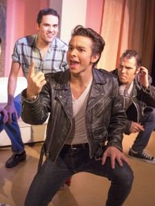 "Danny, center, played by Hollis Higginson, tells the Burger Palace Boys members Doody, left, played by Josh Heinrich and Sonny, played by Mark Stolle, about the girl he met over the summer during rehearsal for ""Grease"" at the Regional Theatre of the Palouse on Oct. 30 in Pullman."