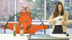 Sarah Culora inks an intaglio print during a printmaking class at the University of Idaho in Moscow on Oct. 31.