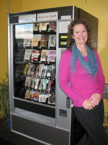Nancy Morrison stands next to her snack machine dubbed Vincent Art à la Carte, which sells art from 15 Lewiston-Clarkston artists. An artist herself, Morrison was inspired by Art-O-Mats to sell the artwork inside Roosters WaterFront Restaurant in Clarkston.