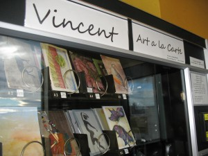 Art sits inside the metal rings of Vincent Art à la Carte, a snack machine that sells art from 15 Lewiston-Clarkston artists. Vincent is located inside Clarkston's Roosters WaterFront Restaurant.