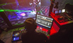 "From a booth overlooking the dance floor, Nick ""DJ CnDyCain"" Cain plays dance music Nov. 9 at CJ's in Moscow."