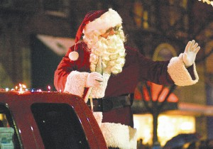 File photo by Geoff Crimmins Santa Claus waves to children in the 2010 Light Up the Night Parade in downtown Moscow.