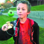 Matthew Dill, 11, of Lewiston concentrates of the seemingly simple task of catching the ball with the cup.