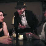 Nathanael Tucker (center) plays a detective in the film noir short shot in downtown Lewiston.