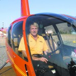 Mark Stanton owner of Kiwi Air sits in his helicopter west of the Quality Inn in Clarkston.