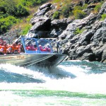 "Snake River Adventures combines the speed of jet boats and the thrills of a raft trip in its 30-passenger ""boogie boat ."""