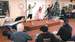 "From left to right, Kelani, 12, Sajsteen or ""Kaleolani,"" 10, and  Kiara or ""Hokulani,"" 14, dance during a  Kumu Hula O Lei Kukui O Moloka'i school practice in preparation for the ""Special Christmas Card From Hawaii"" dinner and show."