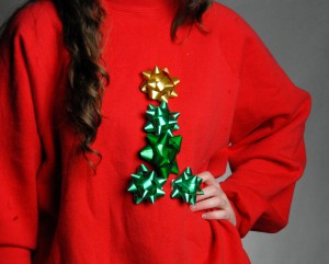 This simple creation can be decorated by covering a sweater an entirely with gift wrapping bows, or by making a color-coordinated shape, such as this Christmas tree, or a candy cane.