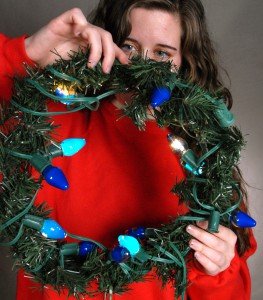 A lighted wreath makes for festive threads, but beware — it's better to leave the lights unplugged. During this photoshoot, one minute of powered lights around the neck resulted in smoking hair.