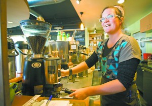 Barista Grace Zeller talks to a customer while making a latte at the Moscow Food Co-op on Tuesday.