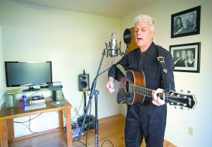 "John Cronin performs in the recording studio in his Moscow home on Friday. Cronin released a released a roots rock album, ""The Museum of Broken Hearts,"" in December."