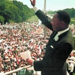 """This Aug. 28, 1963, photo shows Dr. Martin Luther King Jr. acknowledging the crowd at the Lincoln Memorial for his """"I Have a Dream"""" speech during the March on Washington. Monday, Jan. 17, 2011, marks the 25th federal observance of the birth of King, one of America's most celebrated citizens, and the only non-U.S. president to be honored with a national holiday.  (AP Photo/File)"""