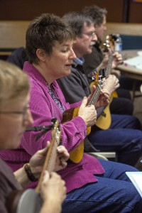 """Connie Stieger, left to right, Shelly Gilmore, Scott Hallett and Jim Kenyon play and sing """"Yellow Rose of Texas"""" with other Ukelele Players of the Palouse members during practice Thursday at Simpson United Methodist Church in Pullman."""