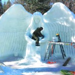 """Dennis Ackerman at work on """"Guardian Angels Among Us,"""" on of 25 local sculptures at the 2014 McCall Winter Carnival. (Photo Jennifer Bauer)"""
