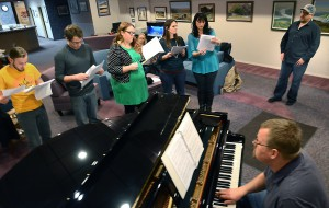 "Dusty Katzenberger, Kirk Gustafson, Jennifer Opdahl, Beth Legg and Connie Evans sing while Ben Bross adds piano music and director Torok Lewis watches practice. The Abuzz Theater Company will perform ""A Night of Musicals."""
