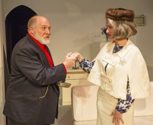 """Victor Velasco, left, played by Randy Emerson, greets Mrs. Banks, played by Jennifer Zambriski, during rehearsal for the Regional Theatre of the Palouse production of Neill Simon's """"Barefoot in the Park"""" on Jan. 30 in Pullman."""