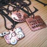 Jennifer Aylward of Bend, Ore., makes copper charms which can be personalized.