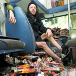 """Ryan Beitz talks about his collection of more than 550 copies of the movie """"Speed"""" in his van in Moscow on April 30."""