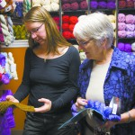 Owner Shelley Stone, left, helps customer Liz Brandt at the Yarn Underground in Moscow. Stone is organizing the Palouse Fiber Arts Festival June 14-15.
