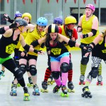 Members of the Hells Canyon Honeys fight for position as they practice at the LC Ice Rink in North Lewiston.