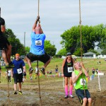 A 20-foot rope climb out of water proved to be one of the toughest obstacles in the 2014 race, slowing down many contestants.
