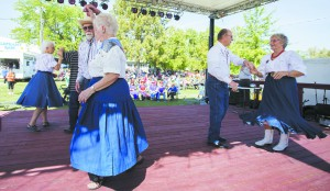 Members of the Palouse Promenaders give a square dancing demonstration Saturday , Sept. 14, 2014, as part of Latah County Fair in Moscow.