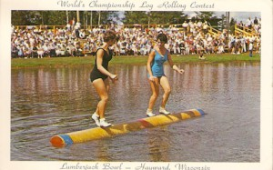 A postcard depicts Bette (Jordan) Ellis of Clarkston, on the right, competing at the Log Rolling World Championships in Hayward, Wis., in the early 1960's.