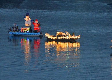 A flotilla of boats circle on the Snake River before the annual Hells Canyon Boat Club lighted boat parade.