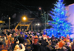 People gather for the Tree Lighting Ceremony in 2009 at the Pine Street Plaza in Pullman.