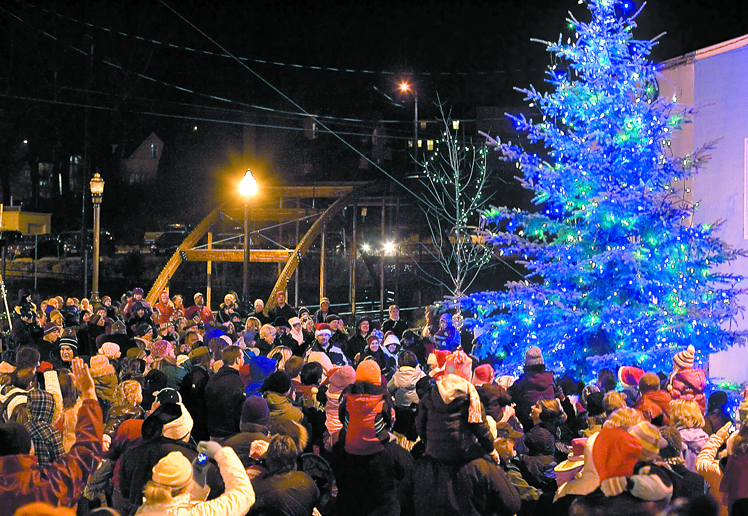 people gather for the tree lighting ceremony in 2009 at the pine street plaza in pullman - Why Is Christmas Called Christmas