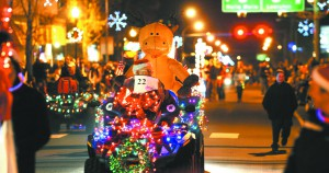 The parade lights up the nighttime sky as floats make there way down Sixth Street in Clarkston during the 2012 Christmas parade.